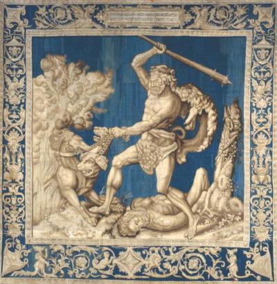 """""""Mach Sitz!"""" - Bei der 12. Arbeit wollen die Widersacher des Herkules auf Nummer sicher gehen und schicken in die Unterwelt, um dort den dreiköpfigen Höllenhund Cerberus einzufangen - aber dem mythologischen Hundeflüsterer gelingt auch dieser Dressurakt!"""
